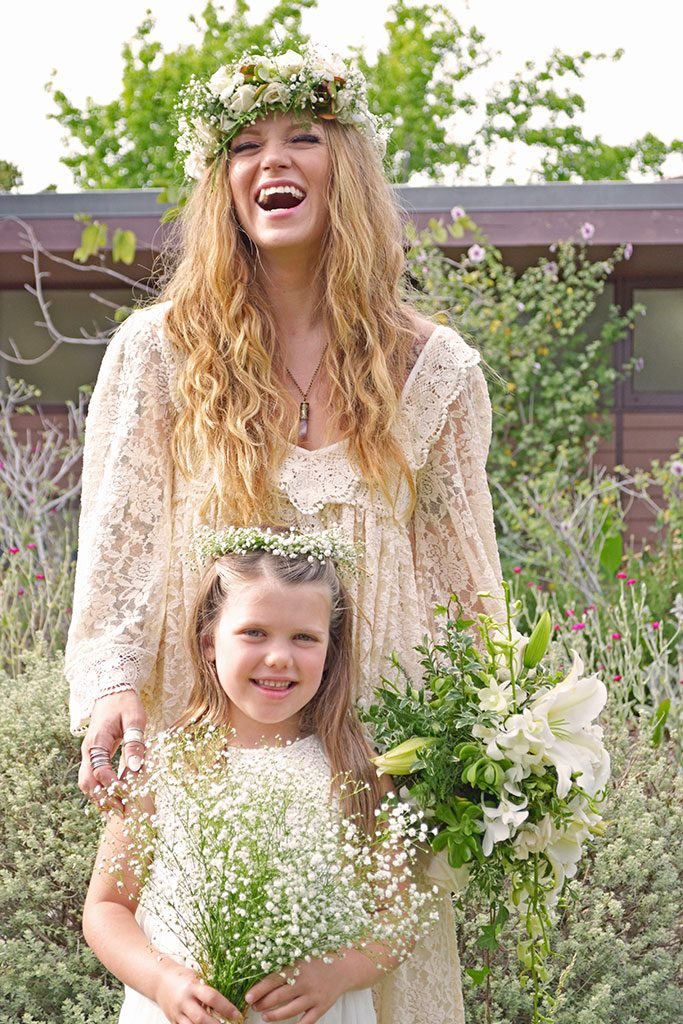 Bride in vintage lace dress with flower crown and flower girl with babies breath bouquet at Oakland wedding, Jackie Rutan Photography, Oakland..