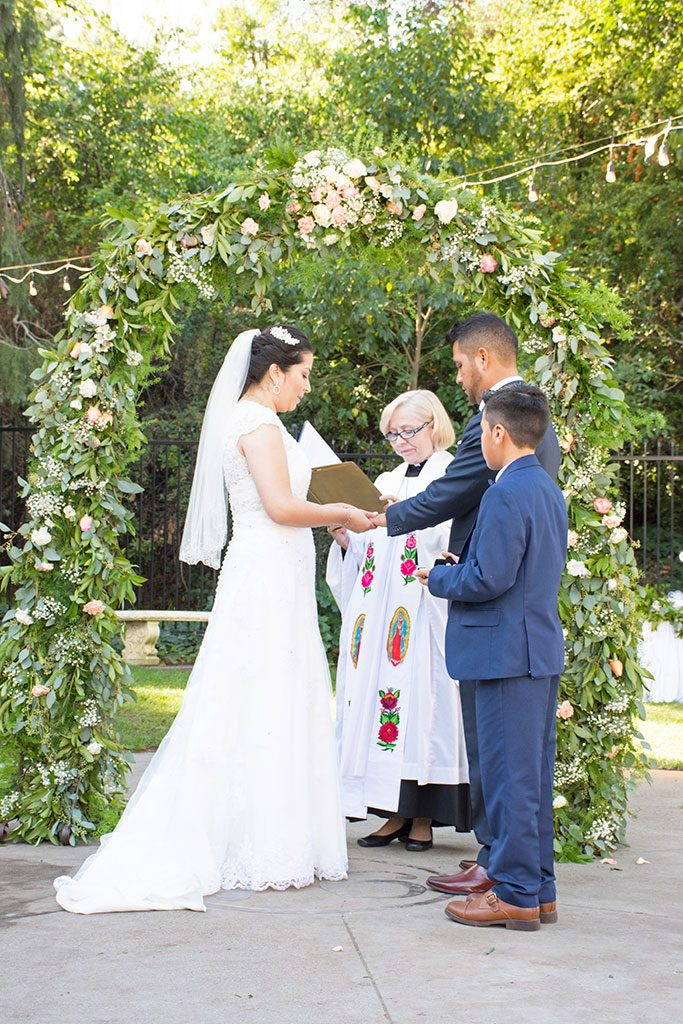Beautiful outdoor wedding with flower archway captured by Jackie Rutan Photography of Oakland.