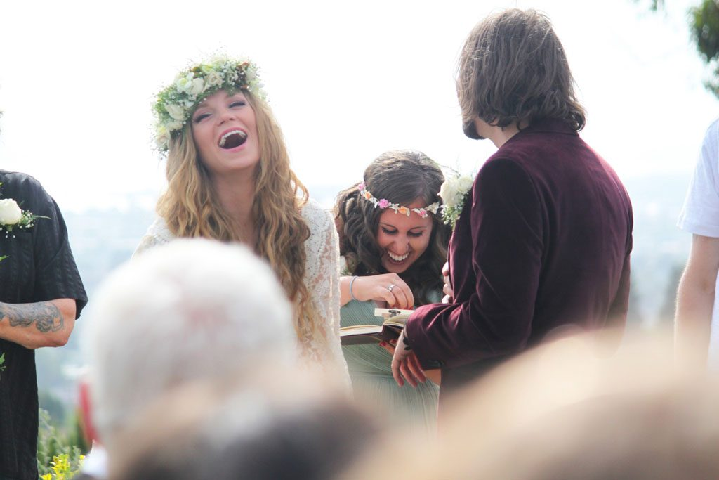 Candid photo moment during Oakland wedding.